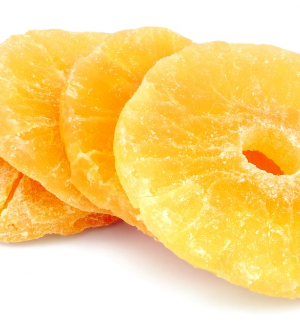 Dried ?andied pineapple rings isolated on white background.