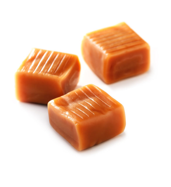 caramel candy  close-up on white background