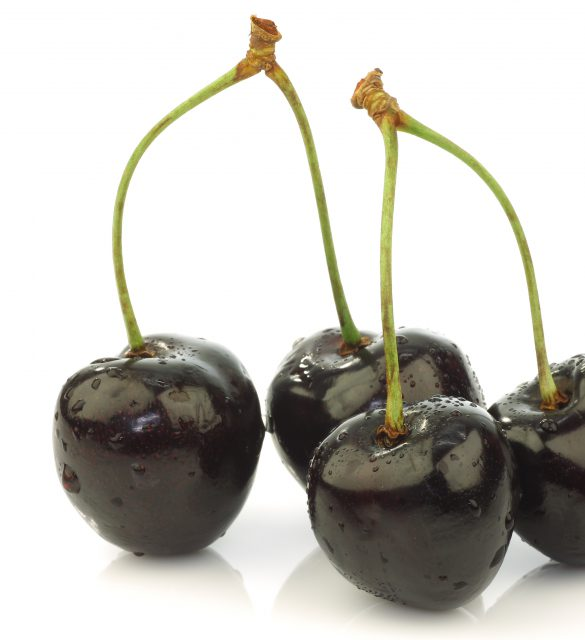 black sweet cherries on a white background