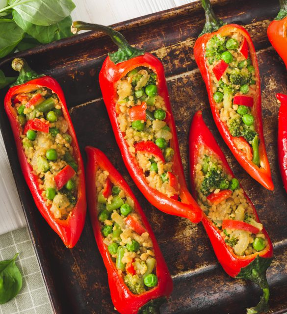 Cooking Vegan stuffed pepper with soy meat and vegetables on the table