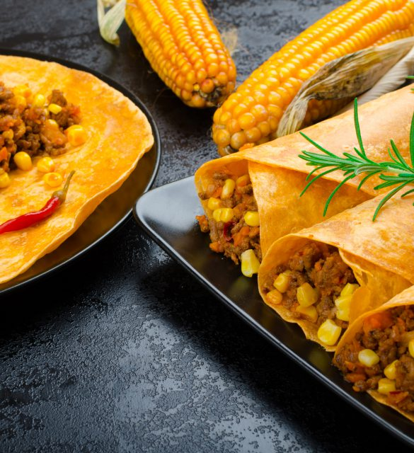 Tomato tortilla with spicy meat mixture, jalapeno, thyme and corn