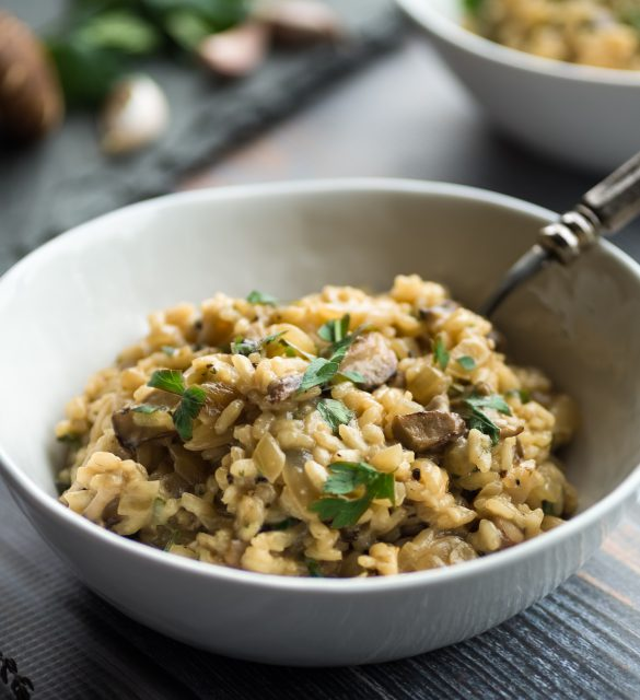 Delicious mushroom risotto with thyme and parsley garnish