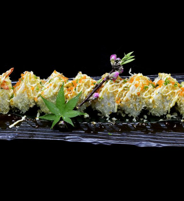 ebi tempura maki. Japanese sushi shrimp tempura roll on black isolated background. Japanese tradition fusion food style.