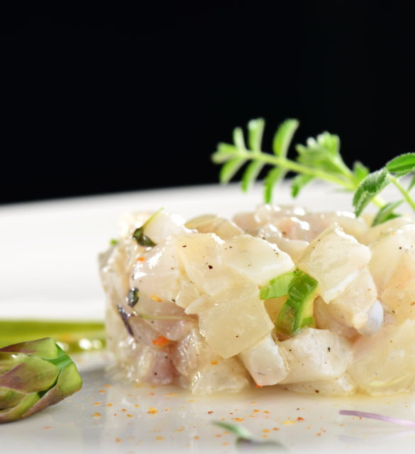 Fine dining appetizer, fish tartare with asparagus