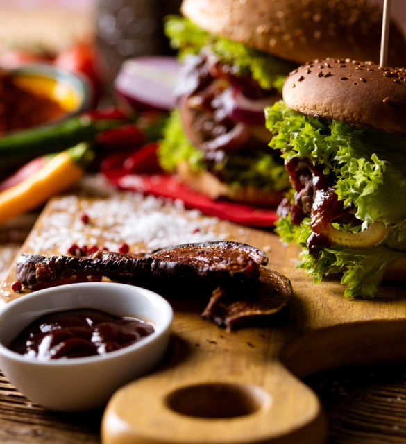 American burgers with spices, hot grilling meat