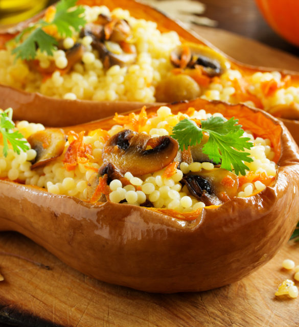 Pumpkin stuffed with couscous with grilled mushrooms.
