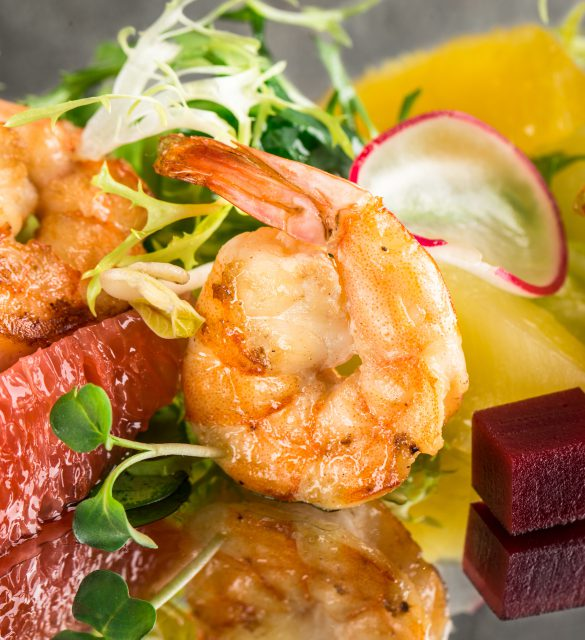 Close up of citrus shrimp salad with mirror reflection