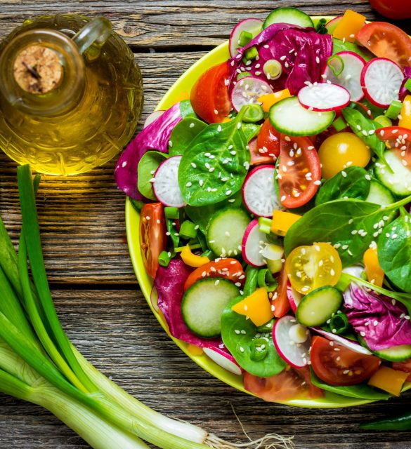 Fresh vegetable salad on wooden background