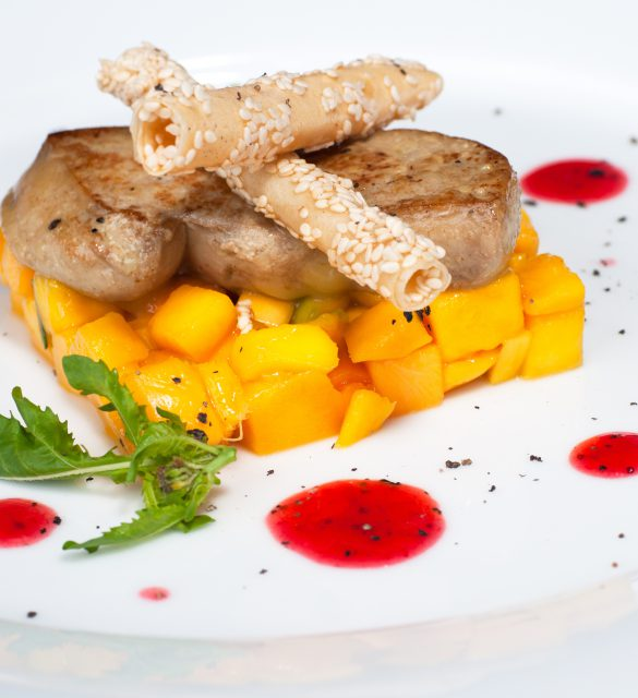 Pan seared foie gras on ripe mango and pomegranate reduction